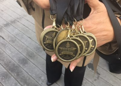Medals awarded to Students by Kysmet Security