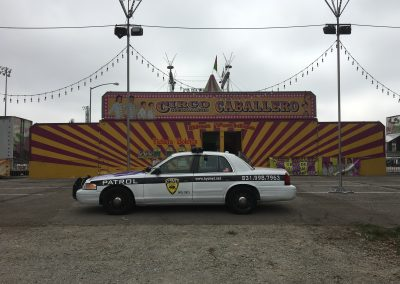 Kysmet Security and Patrol Car in front of circus